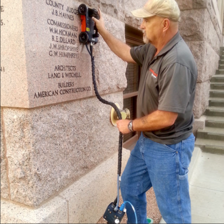 Man using the 1600 MHZ to assess the condition of concrete
